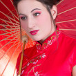 Close up portrait of beautiful woman in red japanese dress with — Stock Photo