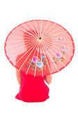 Back view of sitting girl in red japanese dress with umbrella is — Stock Photo