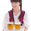 Beautiful waitress in bavarian dress with beer — Stock Photo