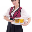 Cute waitress in bavarian dress with beer — Stock Photo