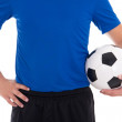 Soccer player in blue with a ball isolated on white background — Stock Photo