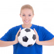 Young beautiful woman in blue shirt with soccer ball — Stock Photo