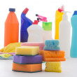 Plastic bottles of cleaning products and sponges isolated on whi — Stock Photo