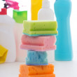 Sponges and plastic bottles of cleaning products isolated on whi — Zdjęcie stockowe