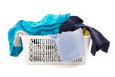 Dirty clothes in a laundry basket isolated on white — Stock Photo