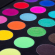 Make up colorful eyeshadow palettes over black — Stock Photo