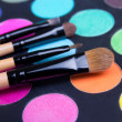 Make-up colorful eyeshadow palette and brushes — Stock Photo