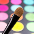Make-up brush and colorful eyeshadow palette close up — Stock Photo