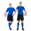 Male and female soccer players in blue uniform with a balls on w — Stock Photo
