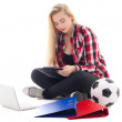 Young blondie woman sitting with laptop, folders and soccer ball — Stock Photo