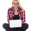 Young blondie woman sitting with laptop isolated on white — Stock Photo