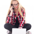 Young blondie woman sitting with laptop and mobile phone isolate — Stock Photo #33345745
