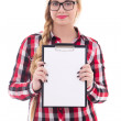 Attractive teenage girl in eyeglasses holding empty blank in her — Stock Photo