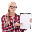 Attractive schoolgirl in eyeglasses holding empty blank in her h — Stock Photo