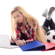 Blondie woman lying with laptop, folders and soccer ball isolate — Stock Photo