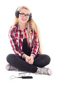 Young happy blondie woman listening music in headphones isolated — Stock Photo