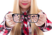 Modern black eyeglasses in female hands — Stock Photo