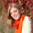 Portrait of young beautiful woman in autumn park — Stock Photo