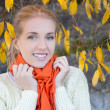 Portrait of beautiful woman in white sweater posing against ston — Stock Photo