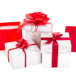 Gift bags and boxes with red ribbon on white background — Photo #34131349