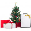 Decorated christmas tree, gift boxes and gift list on white back — Stock Photo