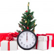 Decorated christmas tree, gift boxes and clock on white backgrou — Stock Photo