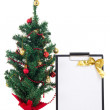 Decorated christmas tree and gift list on white background — Stock Photo