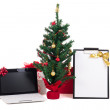 Decorated christmas tree, computer and gift list on white backgr — Stock Photo