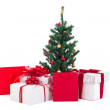 Decorated christmas tree and gift boxes on white background — Stock Photo