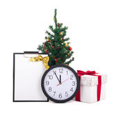 Gift box with red ribbon, wish list, christmas tree and clock on — Zdjęcie stockowe