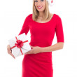 Young woman in santa hat posing with gift isolated on white back — Stock Photo