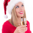 Beautiful young woman in santa hat dreaming with glass of champa — Foto de Stock
