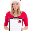 Portrait of young woman in santa hat with wish list isolated on  — Stock Photo