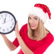 Beautiful woman in santa hat with clock posing isolated on white — Photo