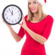 Young woman in santa hat with clock posing isolated on white — Stok fotoğraf