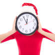 Woman in santa hat holding clock over white — Stok fotoğraf