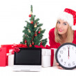 Woman lying down with clock,notebook,  christmas tree and gifts  — Photo