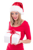 Happy woman in santa hat with gift — Stock Photo