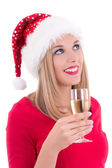 Beautiful young woman in santa hat dreaming with glass of champa — Stockfoto