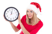 Beautiful woman in santa hat with clock posing isolated on white — Stock Photo