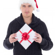 Young man in woolen sweater with christmas gift isolated on whit — Stock Photo