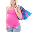 Portrait of young pregnant woman with shopping bags isolated on — Stock Photo