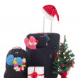 Christmas trip - suitcase and packpack, giftbox and christmas tr — Stock Photo