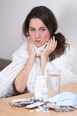 Young attractive woman fighting sickness with pills — Stock Photo