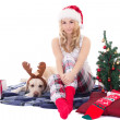 Beautiful teenage girl with dog in reindeer horns and christmas — Stock Photo