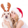 Beautiful teenage girl with dog in reindeer horns isolated on wh — Stock Photo