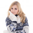 Stock Photo: Young attractive woman posing in winter clothes isolated on whit