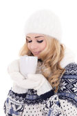 Beautiful girl in winter clothes with cup of tea isolated on whi — 图库照片