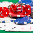 Poker chips, dice and playing cards on the green table — Stock Photo