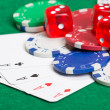 Playing poker chips, dice and cards on the green table — Stock Photo